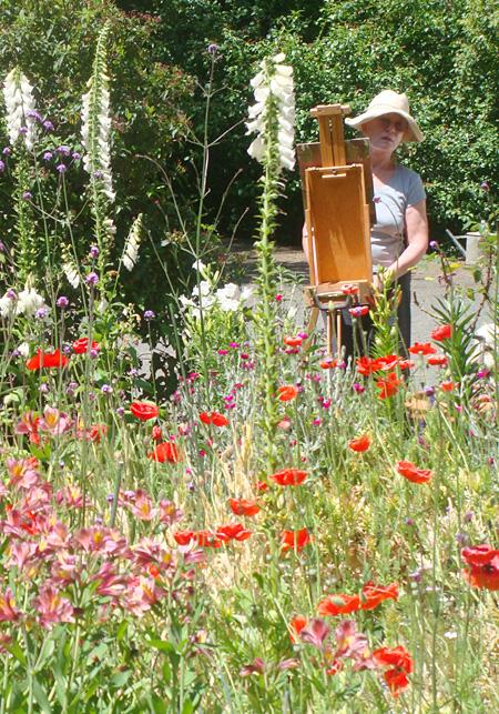 Justina painting in her garden, an official Certified Wildlife Habitat