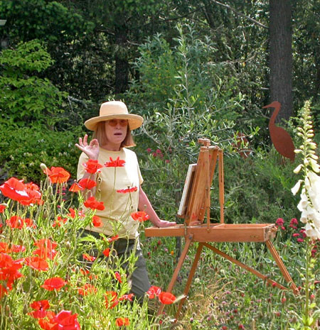"Justina painting ""en Plein Air"" with brilliant red poppies in bloom"